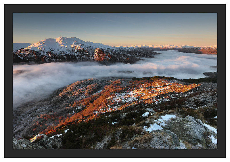 46E0454 First light on Ben Venue and the distant Arrochar Alps and a temperature inversion over Loch Katrine