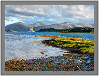A 10180 Early morning light on Castle Stalker and the mountains of Ardgour