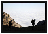 46E6104 Walkers against a sea of clouds