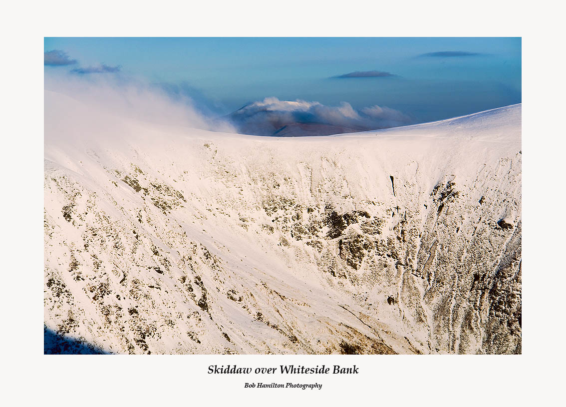 Skiddaw seen through spindrift over Whiteside Bank from Catseye Cam