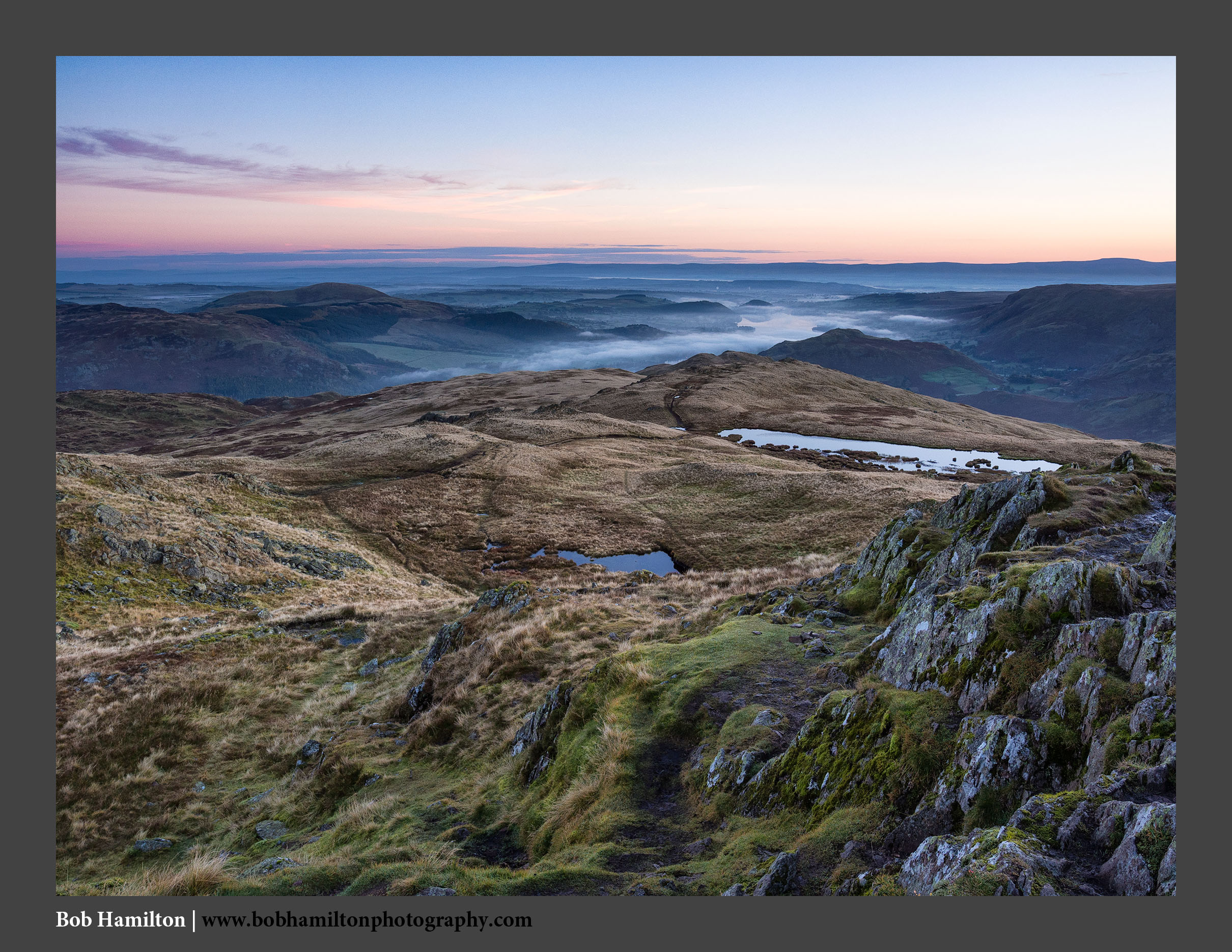 O126418 Dawn breaking on Ullswater and the Pennines from Place Fell