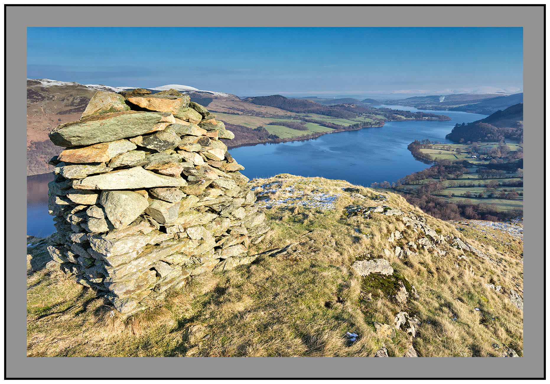 S2015467 The cairn on Kilbert How with Ullswater and the Northern Pennines in the distance