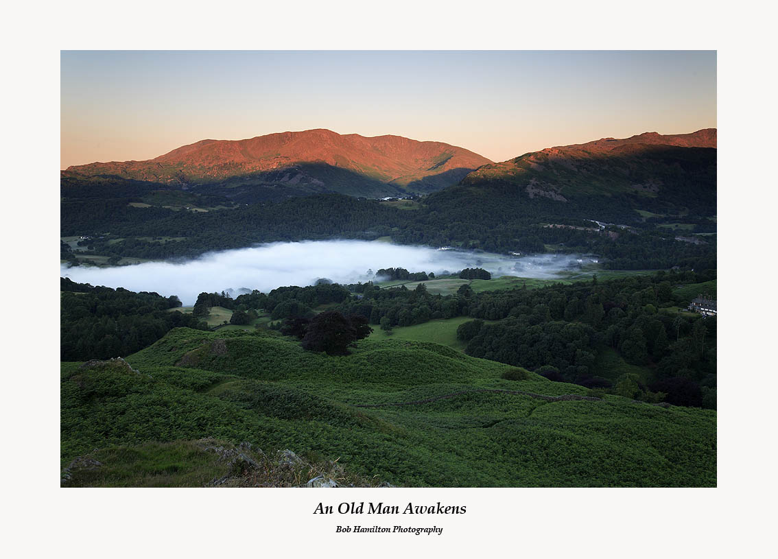 Daybreak on the Old Man of Coniston Wetherlam Swirl How and Great Carrs across Little Langdale