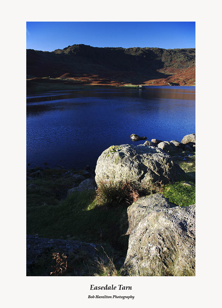 Early morning view across Easedale Tarn to Blea Rigg
