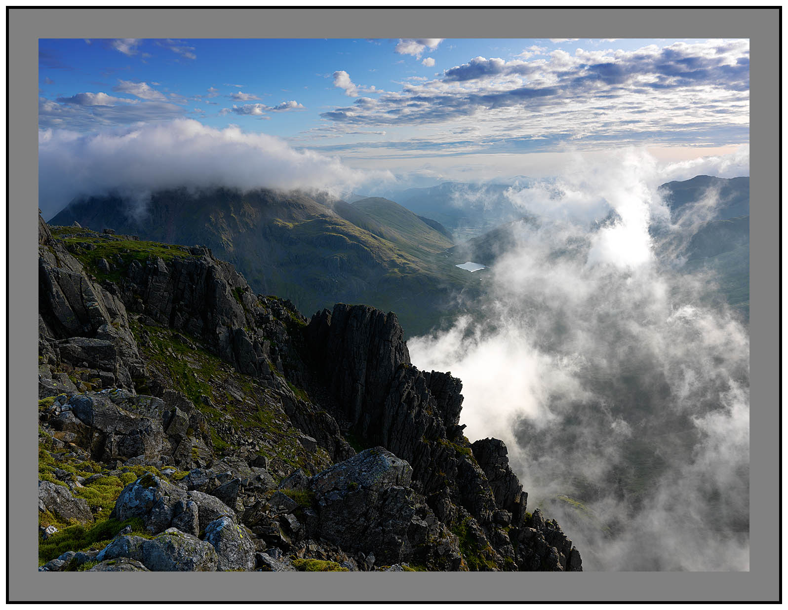 A 5519 Cloud swathes the summit of Great Gable