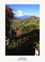 Taormina with a cloud covered Mount Etna in the background