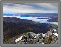 A 7184 A distant snow capped Ben Nevis over Loch Rannoch from Schiehallion