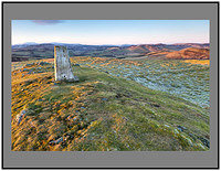 S2015821 The trig point on White Meldon looking south to the snow capped Tweedsmuir and Culter hills