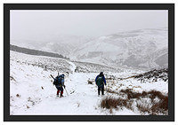46E0698 Walkers descending from Scald Hill in a snowstorm
