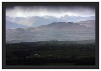 46E1031 Conic Hill and the Arrochar Alps seen through a snowstorm from Dumgoyne