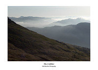 Early morning haze on Ben Lomond over the slopes of Beinn Narnain