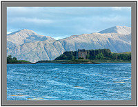 A 10116 Early morning light on Castle Stalker and the mountains of Ardgour
