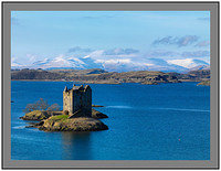 A 7467 Castle Stalker with the snow clad mountains of Mull beyond